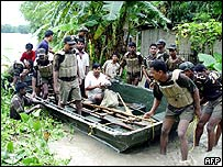 Indian soldiers rescue villagers stranded by floods in the Nalbari district, north-west of Guwahati