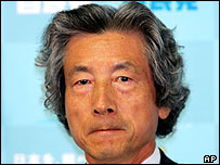 Prime Minister Junichiro Koizumi bites his lips during a press conference at the ruling Liberal Democratic Party headquarters in Tokyo, Monday, July 12, 2004