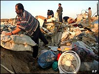 Palestinians search through rubble after demolitions