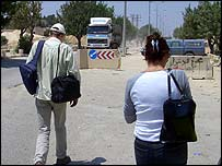 Reynolds and colleague walk towards Bethlehem-Jerusalem checkpoint