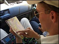 Reynolds consults map in car