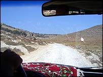 View of road towards Hebron through car windshield