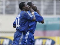 Enyimba players celebrate scoring a goal against Africa Sports of Ivory Coast