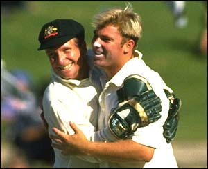Warne celebrates his 100th wicket with Ian Healy at the Adelaide Oval