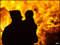 Father and son at bonfire