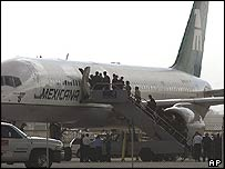 Mexican migrants board plane at Tucson International airport