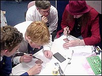 School students working on the mobile phone detector