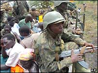 Ugandan soldiers guarding civilians in a truck in northern Uganda