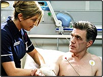 Tina Holbey as Chrissie and Garry Cooper as George Keating in an episode of hospital-based drama series, Holby City