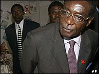 President Robert Mugabe wearing an Aids ribbon