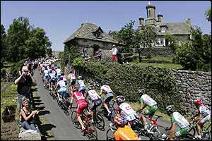The peloton winds through a French village
