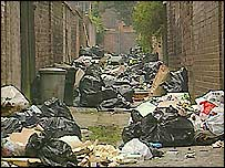 Rubbish piles up along a backstreet