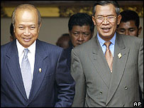 Coalition partners Prince Norodom Ranariddh (L) of the Royalist Funcinpec party, and Prime Minister Hun Sen (R) of the Cambodian People's party leave the National Assembly in Phnom Penh July 15