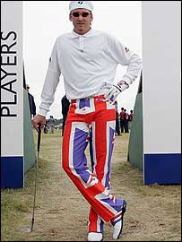 Ian Poulter shows off his trousers before starting his first round