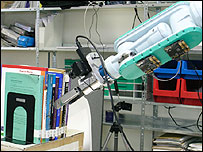 The robot reaches out to grip a book (Image: Robotic Intelligence Lab)