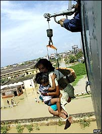 A mother and child are hoisted to safety in Bihar