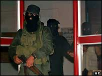 Masked gunmen at the Red Cross offices in Khan Yunis