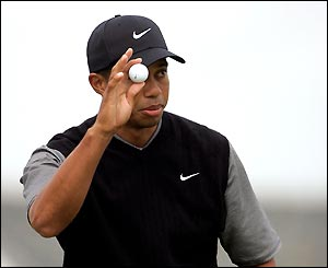 Tiger Woods finishes the day four shots back
