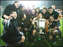 New Zealand celebrate with the Bledisloe Cup