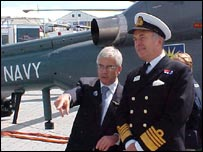 AgustaWestland's Richard Case shows off helicopters to Admiral Sir Alan West, First Sea Lord.