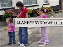 People in Llanfynydd with their village's new long name (pic: Western Mail and Echo)