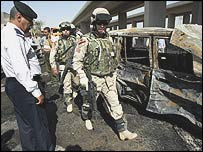 US soldiers secure the site of a car bomb in Baghdad