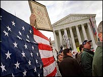 Demonstrators wait outside the Supreme Court for its ruling on the Florida vote