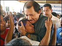 Leader of Nicaragua's Sandinista Revolutionary Front (FSLN) Daniel Ortega is greeted by relatives of those who died during the Sandinista revolution