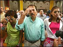 Sandinista leader Daniel Ortega, centre, takes part in a reconciliation ceremony in Managua