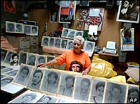 Gloria Martinez, 80, who lost three children during the Sandinista revolution, shows photographs of others who died