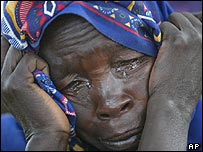 A refugee from Darfur cries after reaching safety in Chad