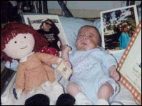Luke Winston-Jones surrounded by his doll
