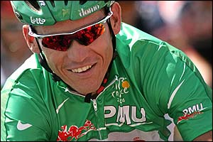 Australia's Robbie McEwen smiles as he rides to the start of stage 15