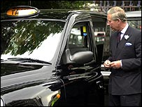 Prince Charles stood by a black cab