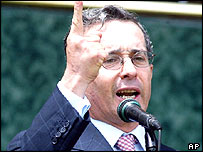 President Alvaro Uribe speaks during a military ceremony in June 2004