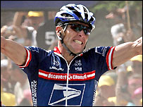 Lance Armstrong celebrates as he crosses the line to win Tuesday's stage