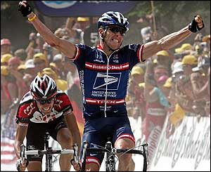 Lance Armstrong crosses the line