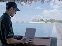 Laptop user in the Maldives