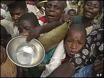 Haitians beg for food and money from church visitors in Saut d'Eau, Haiti, on 16 July