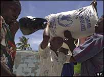 Villagers in Fond Verettes receive food aid after devastating floods