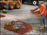 Patrick watering memorial garden
