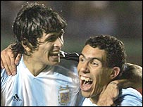 Goalscorers Luis Gonzalez (left) and Carlos Tevez celebrate Argentina's win