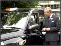 Prince Charles talks with John Sheen after riding in his cab from Clarence House to visit a taxi drivers' shelter in London's Hanover Square, July 20th 2004