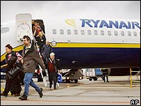 Passengers leave a Ryanair flight