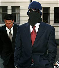 Kelman arrived at court in disguise