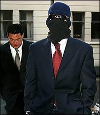 Uriel Zosha Kelman arriving at court in disguise