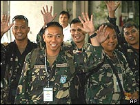 Members of the Philippine peacekeeping contingent from Iraq wave as they arrive at Manila's international airport on Wednesday July 21, 2004