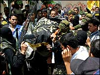 Funeral procession for a Palestinian militant in Gaza City, 23 July 2004