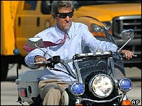 John Kerry rides a motorcycle in Florida