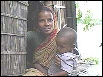Flood victim Josna and her baby in Munshiganj, Bangladesh